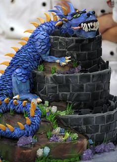 Dragon cake:  I'm thinking the fondant wall roughed into a gray buttercream would work well.