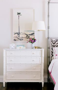 Nightstand with lamp and flowers