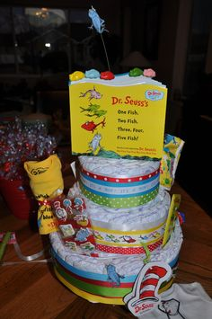 This is a Diaper Cake a friend made for show to use at my Daughter -in laws Baby Shower.  The Theme is Dr. Seus~ one Fish, two fish :)