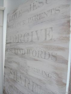 Here's the concept… you print out words on basic white paper, but in mirror image form… lay them on the wood… with a damp paint brush wet the paper on top of the words… use the cap of a sharpie to rub on top of the letters to help them transfer … then remove the paper and stand in shock and awe!