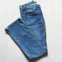 Hollister jeans Very cute and simple hollister jeans. Medium blue wash in color and slightly worn but still in great condition! Has a little bit of distress on the bottom of the left pant leg (seen in last photo). They do have a little bit of stretch to them. Size 7 regular. ❌no trades. Hollister Jeans Boot Cut