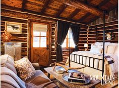 cozy log cabin bedroom, love the bedding and bed