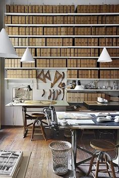Home office with organised kraft magazine files.