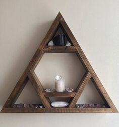 Triangle display shelving with large display centre  Wall mounted or free standing, comes fitted with a hook at the top peak  15 inches from tip to tip  2 1/2 inch depth  finished in refined oak oils and a quality wax for protection Please feel free to contact me with any custom designs to suit you!  Lovelifewood ❤️