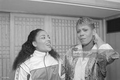 Florence Griffith Joyner, left, meets with Wilma Rudolph, who won three gold medals in Rome in 1960. Rudolph is the director of the Seagram's 'Send the Families' program which paid the expenses of 550 immediate family members of Olympians to come to Seoul. Joyner selected her husband Al Joyner to be her Beneficiary in the program.