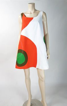 Great vintage Marimekko trapeze dress in an iconic large-scale print of full and partial circles in vivid shades of green, orange and chocolate brown