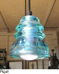 upcycled lamp made of a glass insulator