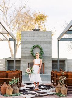 Found Vintage Rentals Demijohns, Cowhide + Wooden ceremony seating