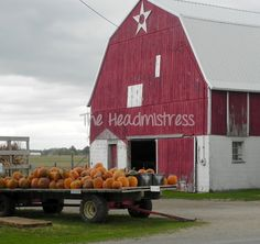 Red barn with pumpkin wagon