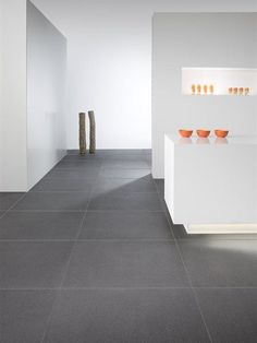 Tiles: The Quartz collection is a new generation of unglazed ceramic floor tiles with a certain richness; pure ceramics thanks to the natural striations of sandy-looking grains and crystal-like p Living Room Tiles, Grey Flooring, Dark Tile Floors, Kitchen Flooring, Living Room Flooring, House Flooring, Ceramic Floor, Flooring, Grey Floor Tiles