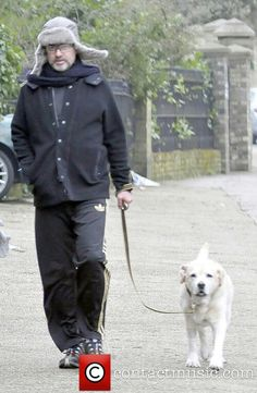 George walking his dog...must be cold outside