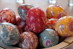 Silk-Dyed Eggs Tie eggs in 100% silk ties, then again with a light colored pillowcase. Cover with water in a pot, add 1/4 cup vinegar, boil for 20 min!