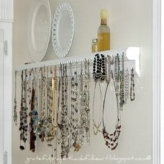 """With a Grateful Prayer and a Thankful Heart: Necklace/Jewelry Organizer (She used 40"""" wood trim that had been put together, sanded, primed, and painted. Added 100 large white upholstery tacks from Lowe's spaced 1"""" apart on the 2 levels.)"""