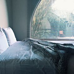 Evening light shines on bed in Austin's Hotel San Jose