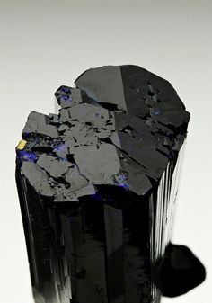 Two intergrown crystals of lustrous dark royal blue Azurite the main crystal displaying striated faces, and excellent pinacoid termination. The smaller crystal is much more tabular in habit, at an angle to the main crystal. From the Tsumeb Mine. Crystal Classics Minerals