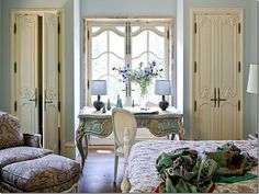 in this bedroom, you can really see the antique wood floors., but the antique quilt and the newer tapestry fabric on the over-sized chair play off of each other very well; Chic & dressy chair fabric paired with the French Casual texture of this quilt...Very pretty room!  Notice the wonderful window and its surround.