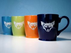 Check out these laughing cat coffee cups from Bread and Badger