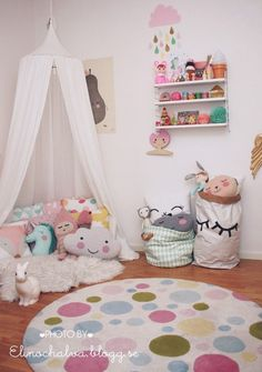 Canopy tent filled with lots of adorable plushies and throw pillows. What little girl wouldn't love to be in this space?