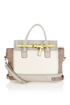 As seen in InStyle magazine. This classic tote style bag has a belted detail to the front and short handles for over the shoulder. With buckle detail all over, this is the perfect daywear bag.