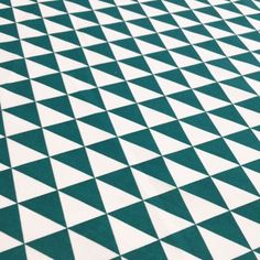 Tissu de coton à triangles verts canard et blancs