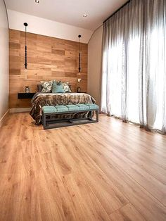 Obsessed with wood like we are? Why not try adding it to your bedroom or lounge wall for something different?  Laminate floors can be installed wherever your heart desires, so we designed this floor and wall area for our client who just loved our Black Forest range  Hop on the trendy train today Decor, Home And Garden, Furniture, Wall Decor, Wooden Flooring, Home, Laminate Flooring, Flooring, Lounge