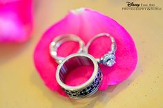 We spy a Hidden Mickey, and a missing petal from a Disney bride's bouquet #Disney #wedding #diamondring