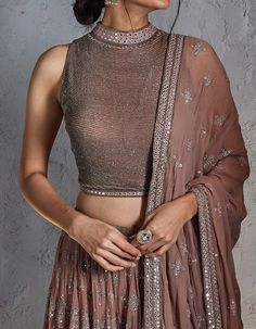 Buy Nude Pink Lehenga Set with a Sleeveless Blouse by NS BY NAKUL SEN Available … - bridge. Indian Wedding Gowns, Indian Gowns Dresses, Indian Bridal Outfits, Indian Fashion Dresses, Dress Indian Style, Indian Designer Outfits, Wedding Lehnga, Indian Blouse, Lehenga Blouse
