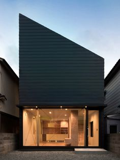 House by Shintaro Fukuhara - Japanese architect Shintaro Fukuhara has completed a glass-fronted house with a steeply angled roof in Kobe, as a home for himself and his family.