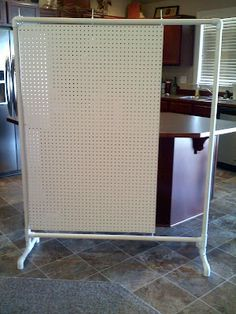 Made a Classroom Divider! Pegboard with room for a pocket chart.