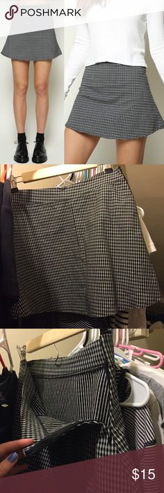 Black and white a-line mini emilia skirt Black and white plaid/ houndstooth /gingham a-line mini skirt I got from Brandy Melville store a few years ago. Wore maybe 3 times since then lol. No damage, stains, tears, etc. Zipper up side. Stiff, but stretchy material.. kind of like what good quality jeggings are made of, if you know what I mean by that. Feel free to ask me any questions! The seam is down the back of the skirt, by the way. Fits as shown on the model. It's OSFM. Would definitely…