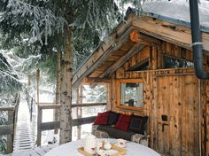 Love this cozy snowy cabin.