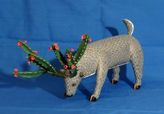 A mystical deer whose antlers are flowering cacti. The artist is Gabino Reyes of La Union Tejalapam Oaxaca Mexico