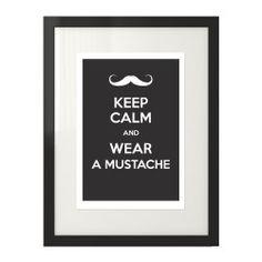 """Plakat typograficzny z białym napisem """"Keep calm and wear a mustache""""  na czarnym tle"""