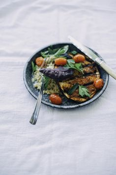 grilled harissa eggplant w/ burst tomatoes, quinoa + herb salad | the first mess for pure green magazine
