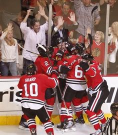 4b4b205615e Chicago Blackhawks celebrate their overtime win over the Detroit Red Wings  in game seven of Stanley