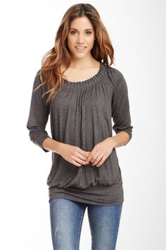 Like the banded bottom and subtle drape on this top.