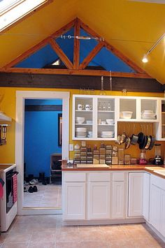 Paint colors that match this Apartment Therapy photo: SW 6342 Spicy Hue, SW 7724 Canoe, SW 6804 Dignity Blue, SW 6370 Saucy Gold, SW 6269 Beguiling Mauve