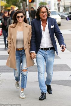 Love is in the air: Mohamed Hadid held hands with his fiancée Shiva Safai during a casual stroll through Beverly Hills on Saturday