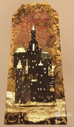Tim Holtz, Cityscape, Metropolis in gold tones on tag