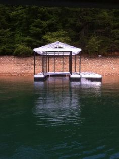 North Georgia Boat Lift & Marine Construction Company began work on a beautiful CAT 3 Hip on Lake Blue Ridge! This dock again features a single-slip combined with a wide-side. The lower deck is constructed using ipe Brazilian hard wood and is wrapped with CAT 5 frame bumper. This dock is unique in that it  contains a side slip. Perfect for extra docking and play! The upper level will consist of a Patricia Bronze coated roof protecting the owner's boat from anything up above! Boat Lift, Lower Deck, Hard Wood, Blue Ridge, Georgia, Bronze, Construction, Outdoor Structures, Play