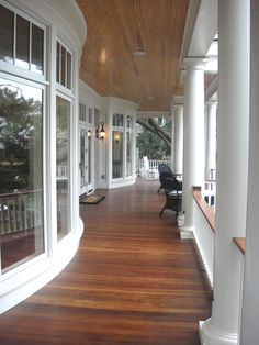 Gorgeous curvy wood/white porch!!!