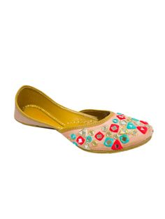 Depicting intricate hand embroidered mirror work on the over-all surface in multicoloured threads, these charming peach juttis are the perfect way to flaunt your feet in style! Designed in silk with a comfortable pure leather sole, this beautifully handmade pair is crafted to give you a perfect snug fit, seamlessly taking the shape of your feet. Your ideal go-to for all ethnic outings, team up these juttis with a floor-sweeping anarkali, a box clutch and a dazzling smile to be the cynosure…