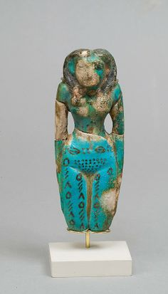 Statue of a Female Figure  Period:    Middle Kingdom Dynasty:    Dynasty 12, late–early 13 Date:    ca. 1850–1640 B.C. ? Geography:    Country of Origin Egypt, Memphite Region, Lisht North, cemetery east of Senwosret (758), Pit 752, MMA 1906–1907 Medium:    Faience, paint Dimensions:    H. 12.7 cm (5 in) Credit Line:    Rogers Fund, 1908 Accession Number:    08.200.18  MMA, New York