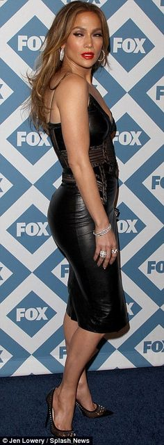 LBD: The 44-year-old multifaceted star donned a leather and lace dress, brown and black heels with jewel accents, and various sparkly jewelry