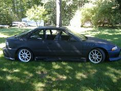 "1991 Acura Integra with a full body kit, 18 inch rims, Z fenders, turbo, lowering springs and shocks, full 3"" exhaust, overbore done on engine, upgraded cams, stage 3 clutch pressure plate and flywheel. Automotive Solutions, Body Kits, Full Body, Audi, Engine, Honda, Stage, Cars, Motor Engine"