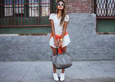 Dress: Reformation Wrap-around sweater: Equipment Sneakers: Isabel Marant Sunglasses: ASOS