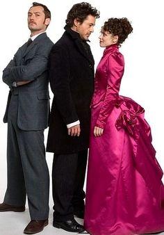 "Badass cast: Jude Law as Watson, Robert Downey Jr. as Holmes and Rachel McAdams as Irene Adler in Warner Bros. worldwide smash ""Sherlock Holmes"" (2009)."