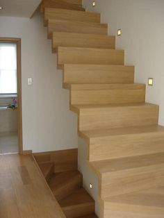 Folded, self supported stairs, should leave small gap by the wall - wood clad probably too spennie