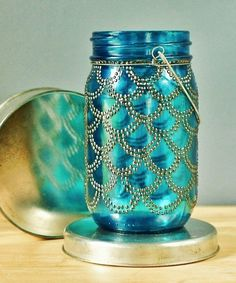 Sea Glass Mason Lantern. These are sold out and really expensive, but click through for a DIY version.