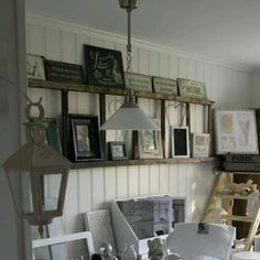 What an awesome way to display pictures. Time to watch for an old wood ladder!